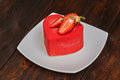 Red cake in the shape of heart on Valentine`s Day