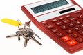 The red calculator with a keys on a white background Royalty Free Stock Photo