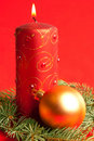 Red candle and ball on fir Royalty Free Stock Photography