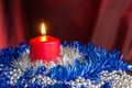 Red candle with a blue and silver decor christmas Royalty Free Stock Image