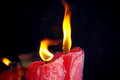 Red candle burning two in temple Stock Images