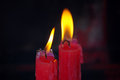 Red candle burning two in temple Royalty Free Stock Photography