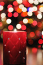 Red candle with disco lights in background Royalty Free Stock Photo