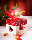 Red candle with heart and flower Stock Photography