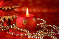 Red candle and pearls Stock Photos