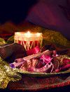 Red candle & potpourri still life Stock Photos