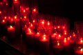 Red Candle row bokeh in the dark Royalty Free Stock Photo
