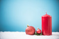 Red candle in snow, Christmas design template