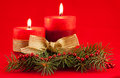 Red candle with xmas tree two candles on background Royalty Free Stock Photo