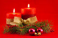 Red candle with xmas tree two candles and purple toys on background Stock Photography