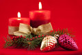 Red candle with xmas tree two candles and toys on background Stock Photography