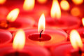 Red candles background backgrounds and textures close up shot of burning selective focus holiday or celebration Royalty Free Stock Photo