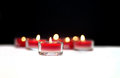 Red candles burning on black and white background Royalty Free Stock Photos