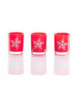 Red candles candle holders with crystal snowflakes isolated on reflective white perspex background copy space christmas Stock Photography