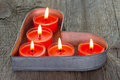 Red candles on a heart shaped tin tray Royalty Free Stock Photo