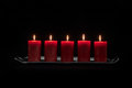 Red candles in a row burning Royalty Free Stock Photo