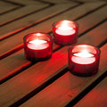 Red candles on warm wood background Royalty Free Stock Photo