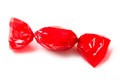 Red candy wrapped in foil Stock Images