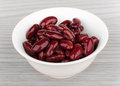 Red canned white beans in glass bowl on table Royalty Free Stock Photo