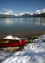 Red Canoe Fresh Snow Lake McDonald Glacier National Park Montana Royalty Free Stock Photo