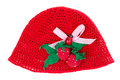 Red cap with crocheted brooch in the form of strawberries Stock Image