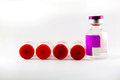 Red cap and purple label injection vials Royalty Free Stock Photo