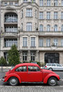 Red car background Beetle on white classic old building Royalty Free Stock Photo