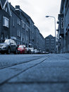 Red car on monochrome urban scene. Stock Photos