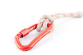 Red carabiner with a white rope Royalty Free Stock Images