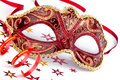 Red carnival mask with confetti and streamer masquerade Stock Photo