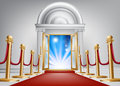 Red carpet entrance a with velvet rope and imposing marble doorway leading into an exciting venue Royalty Free Stock Photos
