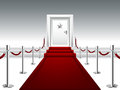 Red Carpet Leading to the Door with Silver Star Royalty Free Stock Photo