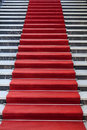 Red carpet marble stairs covered with Stock Images