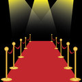 Red carpet with spotlights on black background Stock Images
