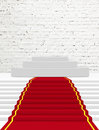 Red carpet stairs covered with Stock Image
