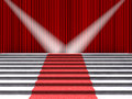 Red carpet on the stairs, lit by two spotlights on a background of red curtains Royalty Free Stock Photo