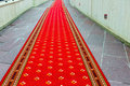 Red carpet on the stairs Royalty Free Stock Photo