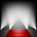 Red carpet and stairs with spotlight up Stock Images