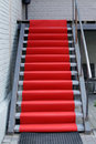 Red carpet stairway with a Royalty Free Stock Images