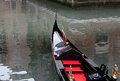 Red carpeted gondola makes way venice canal Royalty Free Stock Photos