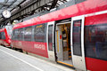 Red carriages of shuttle train on train station Royalty Free Stock Photos