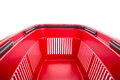 Red cart plastic basket for shopping isolated over white background Royalty Free Stock Photography