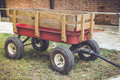 Red cart with wood panel for argriculture Royalty Free Stock Photo
