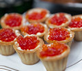 Red caviar in baskets of dough Stock Image