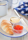 Red caviar and croissant for breakfast Stock Photo