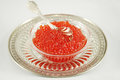 Red caviar dish with isolated with silver spoon and tray Stock Photography