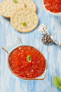 Red caviar in fish shape bowl with crackers closeup Stock Image