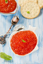 Red caviar in fish shape bowl with crackers closeup selective focus Stock Photo