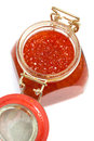 Red caviar in glass jar on a white background Royalty Free Stock Image