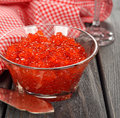 Red caviar on a gray background Royalty Free Stock Photos